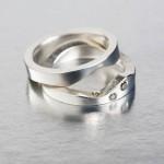 Pusselringar i silver med kaffefärgade diamanter av Petronella Eriksson